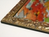 Hand-carved gold leaf frame and beveled mirror
