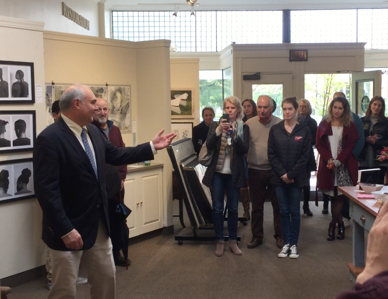 Bob Anthony, president of Adolescent Wellness, Inc. speaks at the Next Up! 2017 Reception at Page Waterman Fine Framing, Wellesley