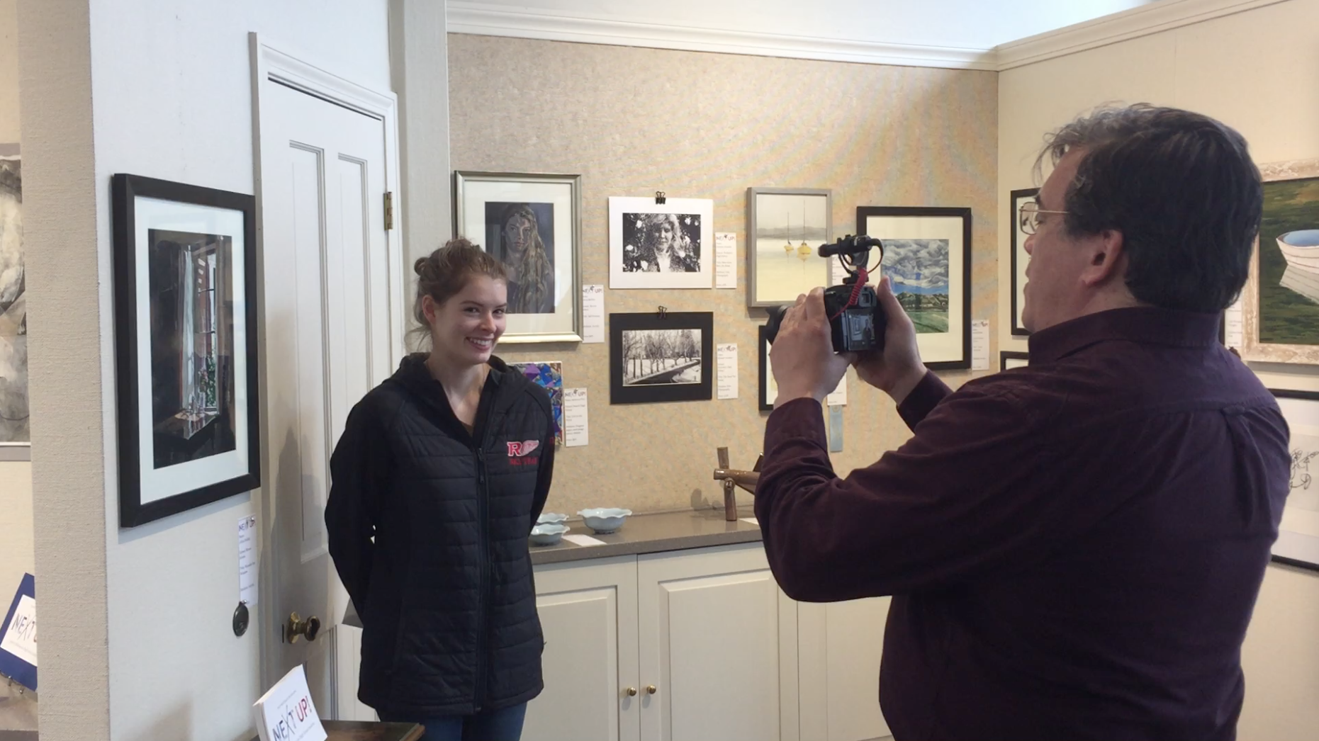 Alicia Bellido being interviewed by Wellesley Media about her First Place award in the Next Up! 2017 juried art exhibition.